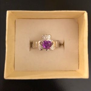Silver Claddagh ring with purple stone